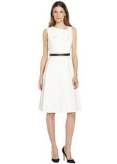 Calvin Klein cream sleeveless dress with black waistband
