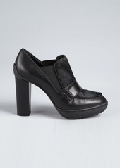 Tod's black leather and calf hair stacked heel booties
